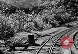 Image of Steam locomotive pushing a train backwards Taiwan, 1940, second 11 stock footage video 65675069924