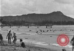 Image of Hawaiian people surfing Honolulu Hawaii USA, 1924, second 12 stock footage video 65675070228