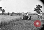 Image of tractor-drawn binder United States USA, 1919, second 2 stock footage video 65675070232