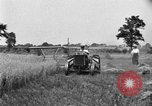Image of tractor-drawn binder United States USA, 1919, second 4 stock footage video 65675070232