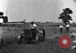Image of tractor-drawn binder United States USA, 1919, second 7 stock footage video 65675070232