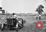 Image of tractor-drawn binder United States USA, 1919, second 9 stock footage video 65675070232