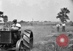 Image of tractor-drawn binder United States USA, 1919, second 10 stock footage video 65675070232