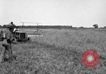 Image of Fordson tractor operating in a field United States USA, 1919, second 8 stock footage video 65675070234