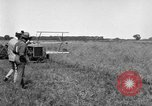 Image of Fordson tractor operating in a field United States USA, 1919, second 9 stock footage video 65675070234