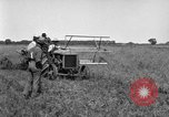 Image of Fordson tractor operating in a field United States USA, 1919, second 12 stock footage video 65675070234