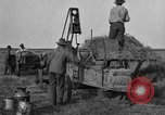 Image of tractor-powered hay baling machine United States USA, 1919, second 1 stock footage video 65675070235