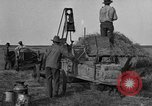 Image of tractor-powered hay baling machine United States USA, 1919, second 2 stock footage video 65675070235