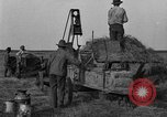 Image of tractor-powered hay baling machine United States USA, 1919, second 3 stock footage video 65675070235