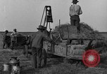 Image of tractor-powered hay baling machine United States USA, 1919, second 4 stock footage video 65675070235