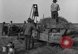 Image of tractor-powered hay baling machine United States USA, 1919, second 6 stock footage video 65675070235