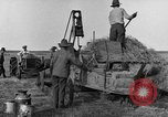 Image of tractor-powered hay baling machine United States USA, 1919, second 7 stock footage video 65675070235