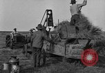 Image of tractor-powered hay baling machine United States USA, 1919, second 8 stock footage video 65675070235