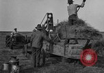Image of tractor-powered hay baling machine United States USA, 1919, second 10 stock footage video 65675070235
