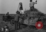 Image of tractor-powered hay baling machine United States USA, 1919, second 11 stock footage video 65675070235