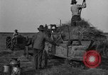 Image of tractor-powered hay baling machine United States USA, 1919, second 12 stock footage video 65675070235