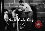 Image of boys boxing competition New York City USA, 1948, second 2 stock footage video 65675070239