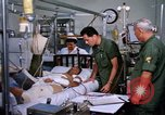 Image of injured man Vietnam, 1968, second 6 stock footage video 65675070270