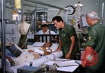 Image of injured man Vietnam, 1968, second 7 stock footage video 65675070270