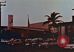 Image of 1950's cars along strip of motels Florida United States USA, 1958, second 9 stock footage video 65675070281