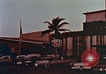 Image of 1950's cars along strip of motels Florida United States USA, 1958, second 10 stock footage video 65675070281