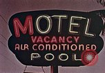 Image of 1950's cars along strip of motels Florida United States USA, 1958, second 11 stock footage video 65675070281