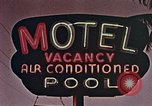 Image of 1950's cars along strip of motels Florida United States USA, 1958, second 12 stock footage video 65675070281