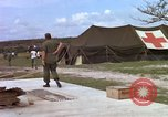 Image of evacuation of casualties Vietnam, 1965, second 7 stock footage video 65675070292