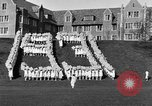 Image of annual hoop roll Wellesley Massachusetts USA, 1931, second 12 stock footage video 65675070441
