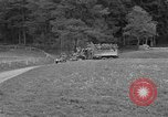 Image of US troops move through villages of Unter-Diessen and Oberdiessen, Bava Unter-Diessen Germany, 1945, second 7 stock footage video 65675070469
