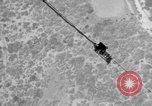 Image of Sailor dangling on cable beneath the USS Akron San Diego California USA, 1932, second 7 stock footage video 65675070494