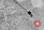 Image of Sailor dangling on cable beneath the USS Akron San Diego California USA, 1932, second 8 stock footage video 65675070494