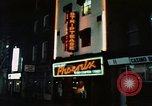 Image of night life Soho London England, 1968, second 4 stock footage video 65675070675
