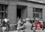 Image of first American newspaper Aachen Germany, 1945, second 8 stock footage video 65675070697