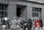 Image of first American newspaper Aachen Germany, 1945, second 10 stock footage video 65675070697