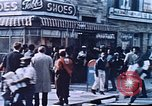 Image of looters robbing Tabbs shoe store Washington DC USA, 1968, second 2 stock footage video 65675070918