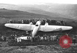 Image of Sightseers  surround downed German Heinkel He-111bomber Scotland United Kingdom, 1939, second 10 stock footage video 65675070948