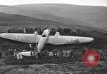 Image of Sightseers  surround downed German Heinkel He-111bomber Scotland United Kingdom, 1939, second 11 stock footage video 65675070948