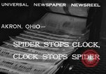 Image of spider in clock Akron Ohio USA, 1932, second 3 stock footage video 65675070961