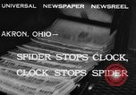 Image of spider in clock Akron Ohio USA, 1932, second 6 stock footage video 65675070961