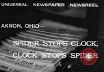 Image of spider in clock Akron Ohio USA, 1932, second 7 stock footage video 65675070961