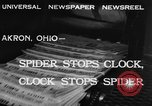 Image of spider in clock Akron Ohio USA, 1932, second 9 stock footage video 65675070961