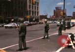 Image of United States soldiers on Guard duty in City Detroit Michigan USA, 1967, second 2 stock footage video 65675071096