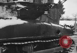 Image of US Soldiers examine damaged US M4 and German Panther tank Sterpigny Belgium, 1945, second 12 stock footage video 65675071156