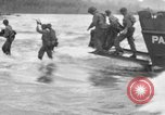 Image of amphibious landing Palau Islands, 1944, second 1 stock footage video 65675071180
