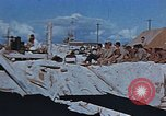Image of Religious services at a bomb crater on Midway Island Pacific Ocean, 1942, second 9 stock footage video 65675071189