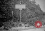 Image of Renault FT tank runs down a street sign Western Front, 1918, second 3 stock footage video 65675071196