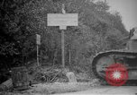 Image of Renault FT tank runs down a street sign Western Front, 1918, second 5 stock footage video 65675071196