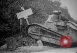 Image of Renault FT tank runs down a street sign Western Front, 1918, second 8 stock footage video 65675071196