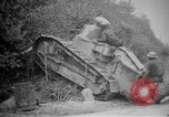 Image of Renault FT tank runs down a street sign Western Front, 1918, second 12 stock footage video 65675071196